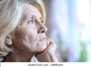 close-up portrait of an old European woman thinking about something