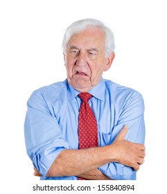 Closeup portrait of an old guy, senior executive, grandfather, with disgust on his face, something stinks,he is very displeased with the situation, isolated on white background. Interpersonal conflict