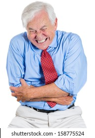Closeup portrait of an old man, elderly executive, boss, corporate worker, retired grandfather doubling over in stomach pain, isolated on white background. Human emotions and facial expressions