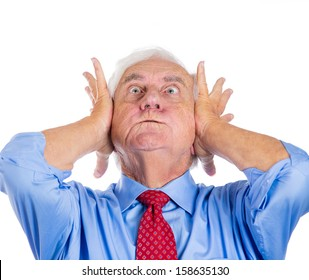 Closeup portrait of an old man, grandfather, corporate executive in blue shirt and red tie covering his ears from loud noise, having a headache isolated on white background.Conflict resolution.