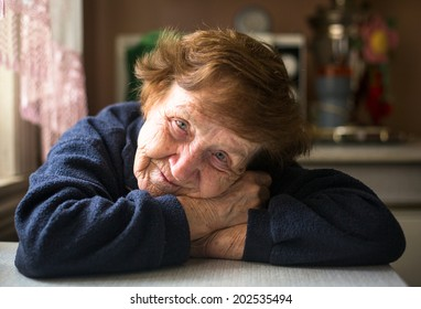 Close-up portrait of old woman in her home.