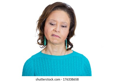 Closeup portrait of old woman, senior employee, grandmother, with disgust on her face, something stinks, she is very displeased with the situation, isolated on white background. Interpersonal conflict