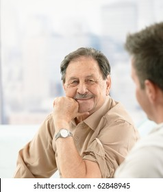 Closeup portrait of older patient smiling at doctor on consultation.?
