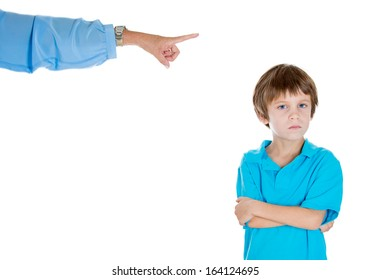 Closeup portrait of parent pointing at child in blue shirt scolding  to go to room grounded for misbehaving while kid is looking disobedient arms folded. Isolated on white background. Negative emotion