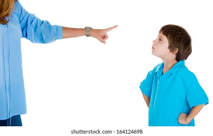 Closeup portrait of parent pointing at child in blue shirt scolding go to room grounded for misbehaving while kid is looking disobedient hands on hips. Isolated on white background.Negative emotion