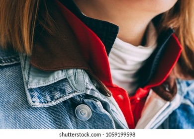 Close-up portrait of person dressed in many layers of clothing: turtleneck, T-shirts, denim jacket.