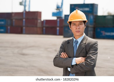 Close-up portrait of a port engineer posing at camera