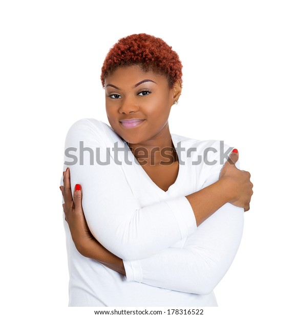 Closeup portrait of pretty beautiful young woman holding hugging herself, isolated on white background. Positive emotion facial expression feeling, reaction, situation, attitude. Love yourself concept
