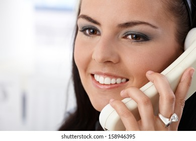 Closeup portrait of pretty girl talking on phone, smiling.
