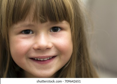 Close-up portrait of pretty little girl. Smiling child