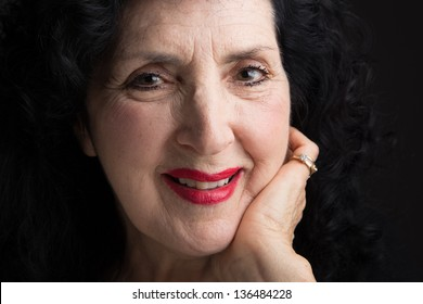 Closeup Portrait of a Pretty Older Italian Woman Looking Directly to the Camera