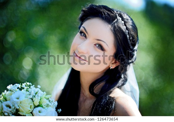 close-up portrait of a pretty shy bride on the outdoor