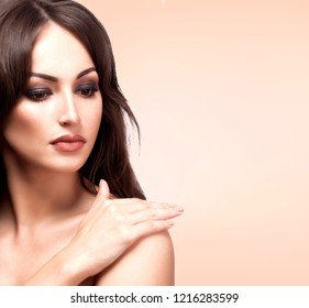 Closeup portrait of pretty woman,  pastel background with a place for your information