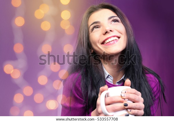 Closeup portrait of pretty young woman against colorful background