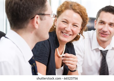 Close-up portrait of red-haired lady big laughing during meeting in Hi Res with her colleagues. Happy lady communicating with her partner man about business and company.