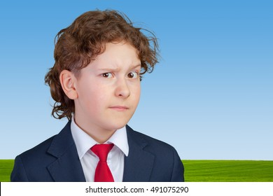 Closeup up portrait of s suspicious, cautious child boy