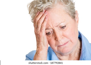Closeup portrait, sad, alone, dark, gloomy, frustrated stressed senior mature woman, hand on head, having really bad nightmare day. Negative emotion facial expression feelings.