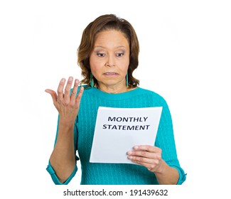 Closeup portrait sad, confused surprised, shocked funny looking senior old woman disgusted at monthly statement isolated white background. Negative emotion facial expression. Financial crisis bad news