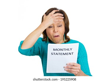 Closeup portrait sad, confused surprised, shocked funny looking senior woman having headache, reading monthly statement isolated white background. Negative emotion facial expression. Financial crisis
