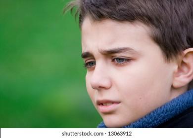 Closeup portrait of a sad teenager