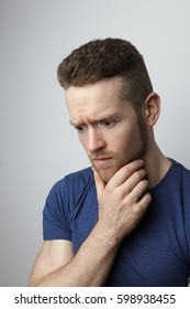 Closeup portrait of sad young man with worried stressed face expression. Obsessive compulsive, anxiety disorders.