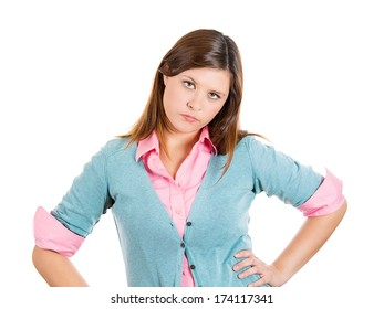 Closeup portrait of sassy brassy cheeky  impudent young woman with hands on hips looking at you cranky, isolated on white background. Negative emotion facial expression feelings, perception reaction