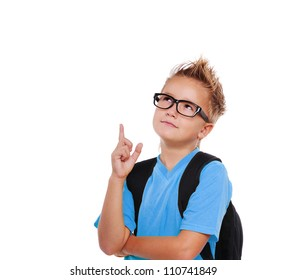 Closeup portrait of a schoolboy in glasses pointing to the copy space area  isolated on white