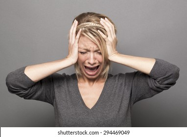 Closeup portrait of screaming young woman covering closed ears and eyes, furious at loud noise, ignoring someone, not wanting to hear their side of story