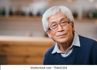 close-up portrait of senior asian man in eyeglasses