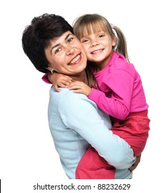 Closeup portrait of senior Caucasian woman with little granddaughter