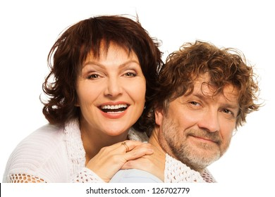 Close-up portrait of senior couple hugging and smiling together