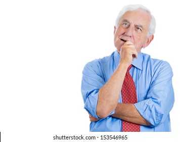 Closeup portrait of senior elderly mature man trying to remember something in deep thought, looking up and daydreaming, isolated on white background with copy space