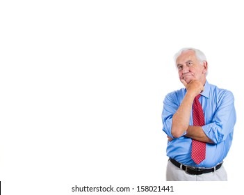 Closeup portrait of senior elderly mature man daydreaming about something that makes him happy, looking up and to the side, life memories of the past, isolated on white background with copy space