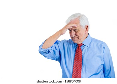 Closeup portrait of senior elderly mature man, old sad businessman with white hair, troubled and in deep thought, isolated on white background with copy space. Human emotions and facial expressions