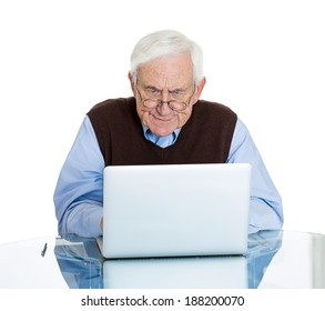 Closeup portrait senior, elderly, mature, man with glasses trying to figure out how use laptop internet isolated white background. Human emotion, facial expression. Age related changes. Old generation