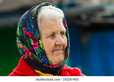 Closeup portrait senior, elderly woman with grey hair on porch of her house, thoughtful, looking away as if she is waiting for someone. Human emotions, facial expressions, life perception, reaction