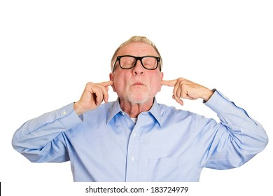 Closeup portrait, senior man, nerd black glasses, covering closed ears, annoyed by loud noise or ignoring someone, not wanting to hear their side of story, isolated white background. Negative emotion