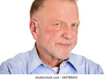 Closeup portrait, senior mature business man,  funny, suspicious annoyed looking being cautious, careful, attentive, thinking, of his own mind, isolated white background. Emotion, facial expression