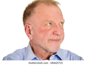 Closeup portrait, senior mature grumpy man with bad attitude looking away annoyed by what you say, isolated white background. Negative emotions, facial expression feelings, body language