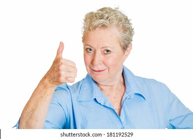 Closeup portrait of senior mature happy, smiling, excited natural woman giving thumbs up sign with fingers, isolated on white background. Positive emotion facial expressions symbols, feelings attitude
