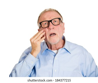 Closeup portrait, senior mature man  thinking, daydreaming, trying hard to remember something looking confused, isolated white background. Negative emotion facial expressions. Short-term memory loss