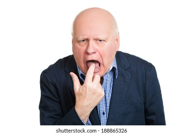 Closeup portrait, senior mature unhappy, annoyed, sick business man putting finger in mouth showing something sucks, isolated white background. Negative human emotion, feeling, facial expression, sign