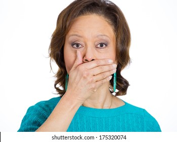 Closeup portrait of senior mature woman covering closed mouth, open eyes. Speak no evil concept, isolated white background. Negative human emotion facial expressions signs symbols. Media news coverup