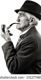 Closeup portrait of a senior smoking a pipe. Black and white