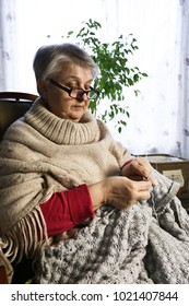 Close-up Portrait of Senior Woman Knitting with Wool, Grandmothers Hands Knit Wool Yarn. Craft is Hobby of Old Women. Senior Lady, Happy Granny Knitted Sweater Handmade.