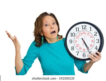 Closeup portrait senior woman worker, holding clock looking anxiously, pressured by lack, running out of time, isolated white background. Human face expression, emotion, reaction, corporate life style