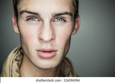 Closeup portrait of sensual man with beautiful face and eyes.