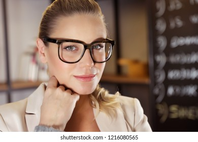 Closeup portrait of a serious business woman in the office, attractive young lady boss, good career and successful future