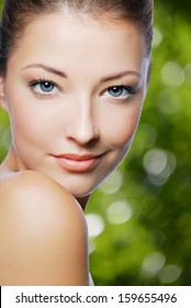Close-up portrait of sexy beautiful young woman with fresh skin of face