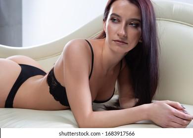 Close-up portrait of a sexy brunette girl in black underwear